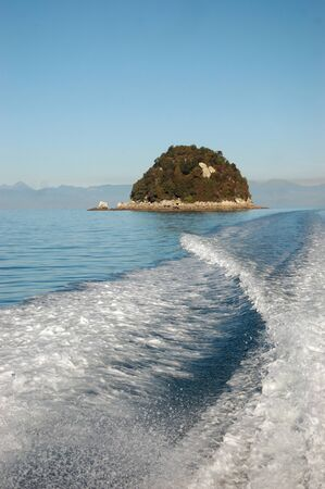Wake of boat and retreating islands, Abel Tasman National Park, South Island, New Zealand photo