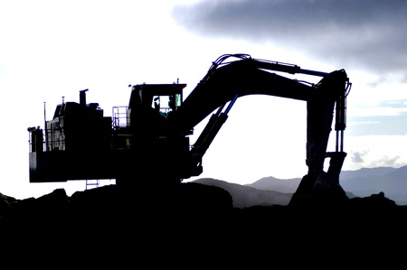 Silhouette of 200 ton digger at Coal Mine, West Coast, South Island, New Zealand photo