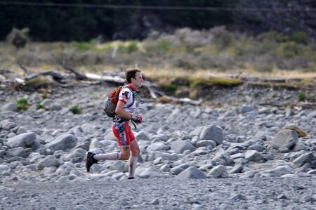 something athletic: man competing in the mountain leg of the Coast to Coast triathlon, West Coast, South Island, New Zealand Editorial