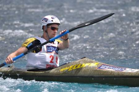 Sam Evans competing in the kayaking leg of the Coast to Coast triathlon, West Coast, South Island, New Zealand, 2011