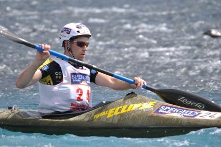 something athletic: Sam Evans competing in the kayaking leg of the Coast to Coast triathlon, West Coast, South Island, New Zealand, 2011