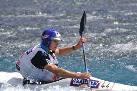 something athletic: Carl Schiller competing in the kayaking leg of the Coast to Coast triathlon, West Coast, South Island, New Zealand, 2011