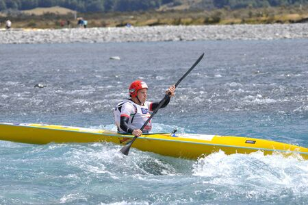 something athletic: man competing in the kayaking leg of the Coast to Coast triathlon, West Coast, South Island, New Zealand, 2011 Editorial