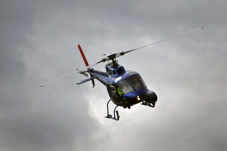 chopper in flight, Westland, New Zealand photo