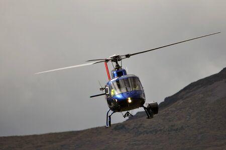 chopper in flight, Westland, New Zealand