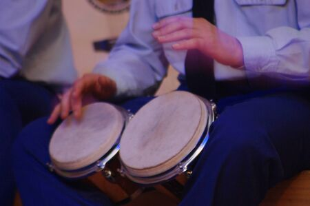 bongos: slightly blurred time exposure of man playing bongos during a live performance