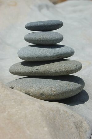smooth stones stacked up on a smooth rock photo