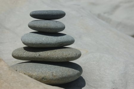 smooth stones stacked up on a smooth rock Stock Photo - 15118110