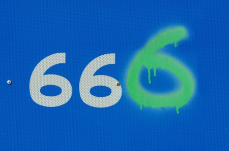 end times: vandalised road sign showing anti christ number 666