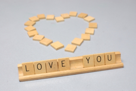 'love you' message spelt out in letters from board game photo