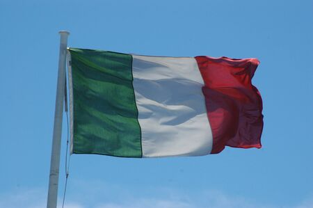 rf: Italian flag blowing in the wind Stock Photo
