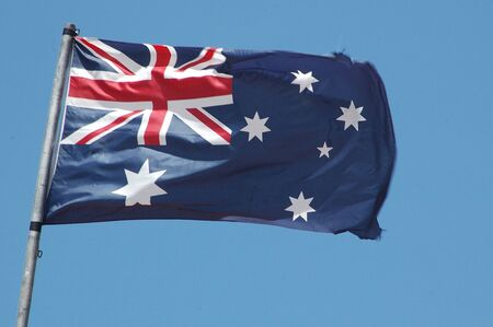 Australian flag blowing in the wind photo