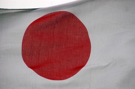 japanesse: Detail of Japanese flag blowing in the wind