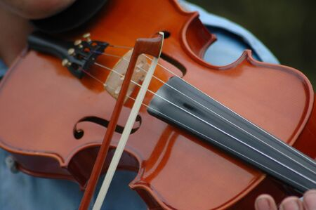 closeup of violin being played photo