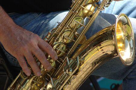 jazzy: closeup of man playing saxophone in jazz band Stock Photo