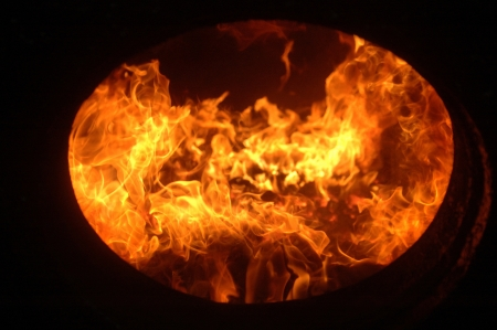 Coal fire inside steam engine of train photo