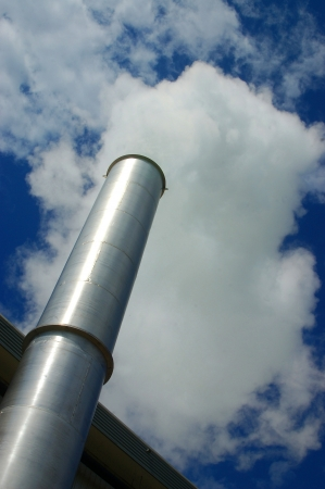 heats: steam arising from chimney on industrial site