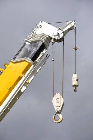 tonne: hook on a 70 tonne crane against a clear sky Stock Photo