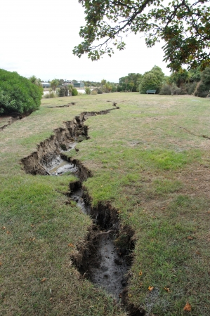 Damage to parkland by the Avon River from the 6.4 earthquake in Christchurch, South Island, New Zealand, 22-2-2011