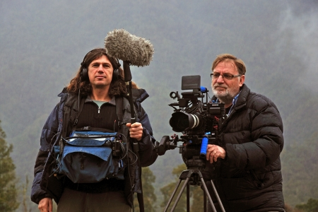 Cameraman and sound recordist at work on the West Coast, New Zealand