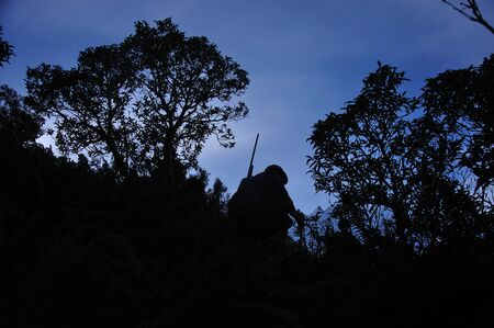 hunters: silhouette of hunter in  South Westlands Southern Alps, New Zealand Stock Photo