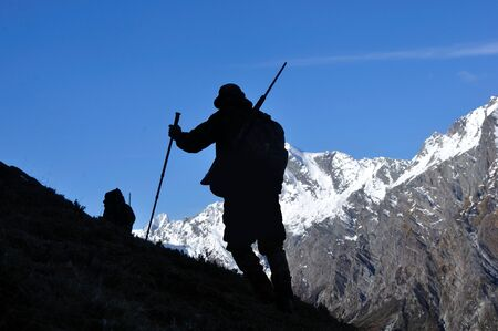 silhouette of hunter in  South Westlands Southern Alps, New Zealand photo