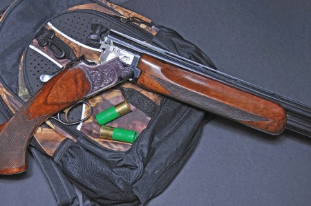 12 gauge shotgun with shells photo