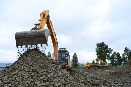 Excavator filling a dump truck at a construction site in Westland Stock Photo - 15893810