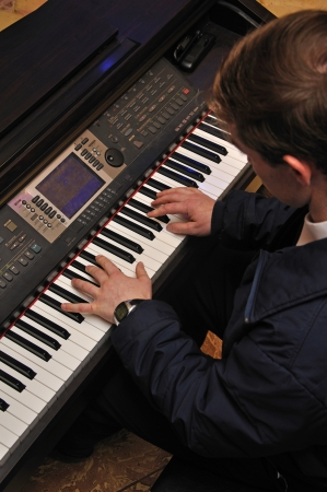 computerised: Detail of a man playing an electronic piano in a live performance
