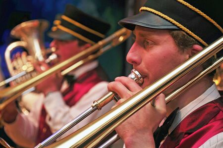 live performance: Brass band member playing a slide trombone in live performance
