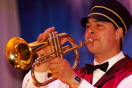 live performance: Brass band member playing a trumpet in live performance Stock Photo