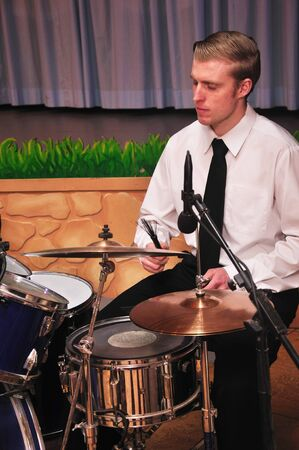 live performance: Detail of a man playing drums in a live performance