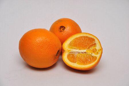 navel orange: whole and sliced navel oranges on a seamless background Stock Photo