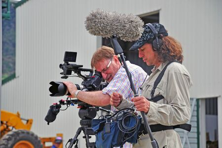filmmaking: Cameraman and sound recordist at work on ocation
