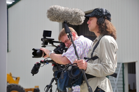 Cameraman and sound recordist at work