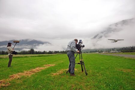 Cameraman and sound recordist at work on location photo