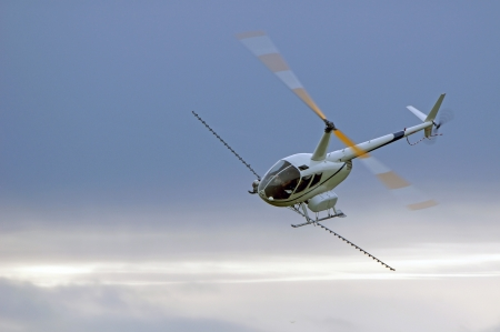 ag: helicopter spraying fertiliser on a crop in Westland, New Zealand Stock Photo