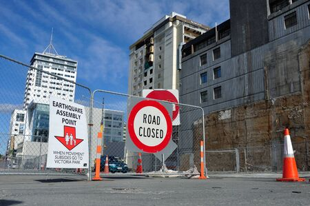 cordoned: CHRISTCHURCH, NEW ZEALAND, NOVEMBER 3, 2012 - Signage directs people to an assembly point if theres another earthquake in Christchurch, South Island, New Zealand