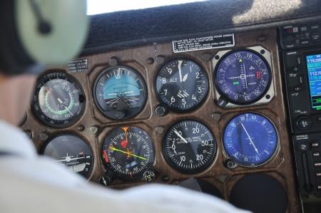 pilot light: Pilot checks the instrument panel of a light aircraft