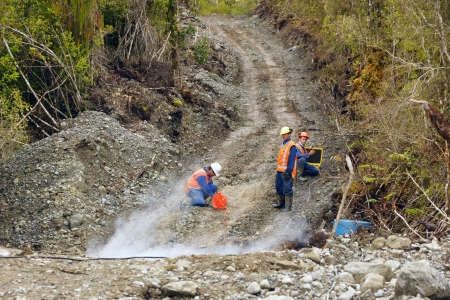 Men setting off explosive charges in a seismic reflective survey looking for oil on the West Coast of New Zealand