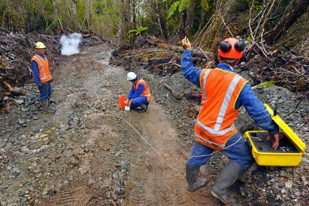 seismic: Men setting off explosive charges in a seismic reflective survey looking for oil on the West Coast of New Zealand