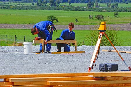 leveling: Builders mark out the profile for a building at a construction site in Westland Stock Photo