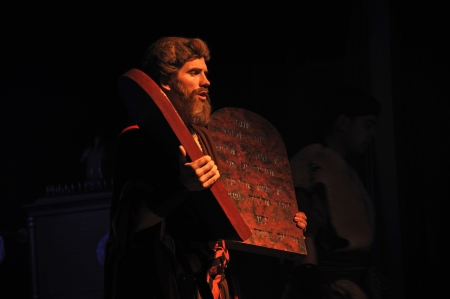 ten commandments: Actor dressed as Moses holding stage props of the Biblical Ten Commandments