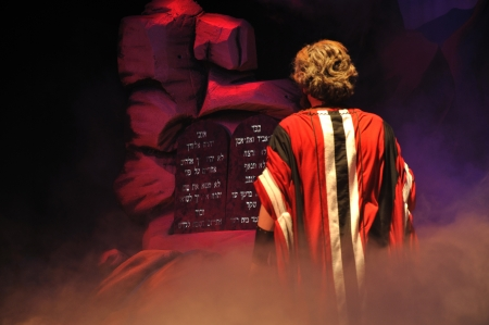 Moses comes face-to-face with the Ten Commandments in a Biblical stage performance Stock Photo