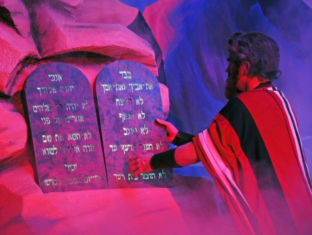 Moses comes collects the Ten Commandments in a Biblical stage performance