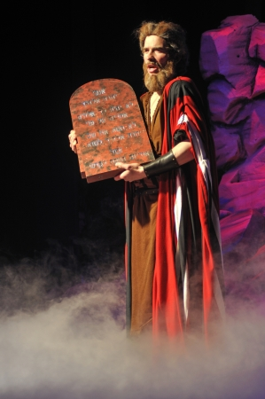 Moses with the Ten Commandments in a Biblical stage performance photo