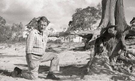 ruination: TOOWOOMBA, AUSTRALIA circa 1983: Professor  Gordon Roberts demonstrates the massive loss of top soil on a badly eroded farm circa 1983 near Toowoomba, Australia. Soil erosion continues to cost farmers millions of dollars.