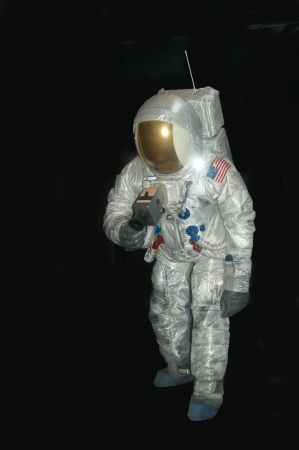 space suit: american astronaut in pressure space suit on black background