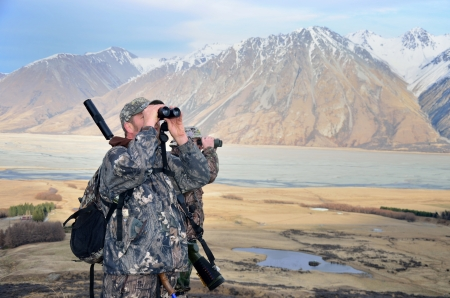 hunters: two hunters searching for Himalayan tahr in the Southern Alps of New Zealand        Stock Photo