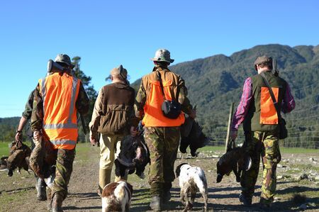 hunters: A group of friends return from their pheasant hunt with plenty of game on the West Coast of New Zealand